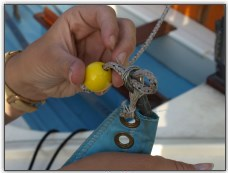 Photo 17, Fixing a rope stopper to a sail