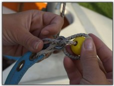 Photo 18, Fixing a rope stopper to a sail