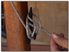 Photo 24, Lock off the halyard rope around the cleat
