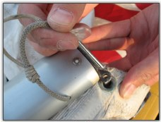 Photo 24, Secure the tack of the mainsail