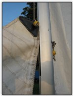 Photo 35, Feed the main sail in to the mast